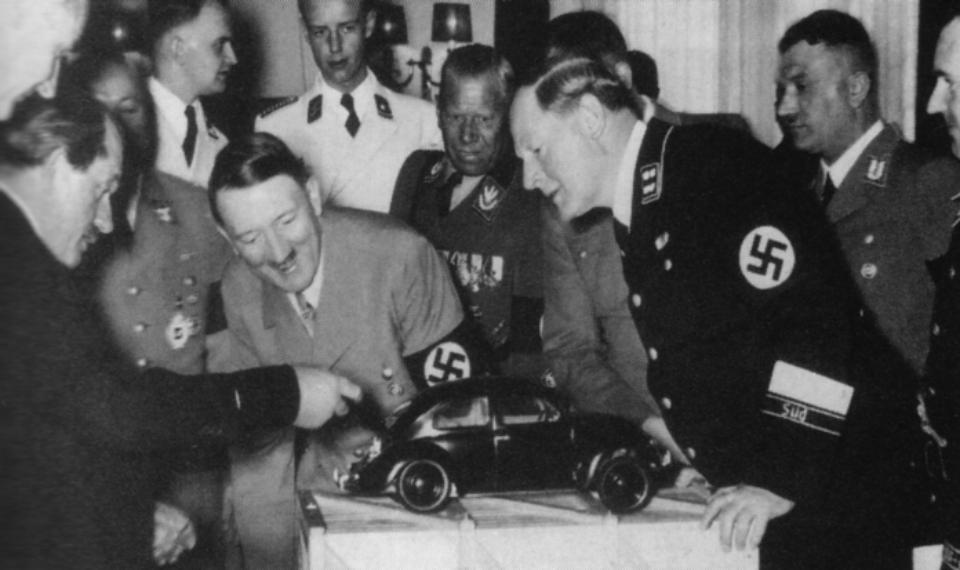 Ferdinand Porsche shows Hitler VW prototype