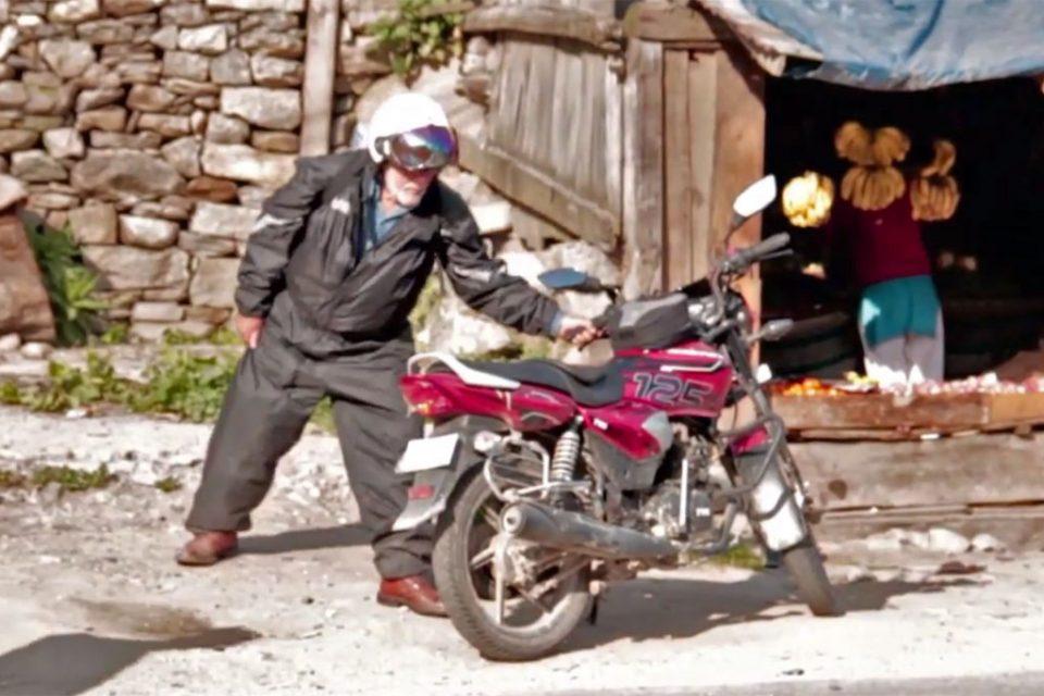Simon Gandolfi struggles to get on bike