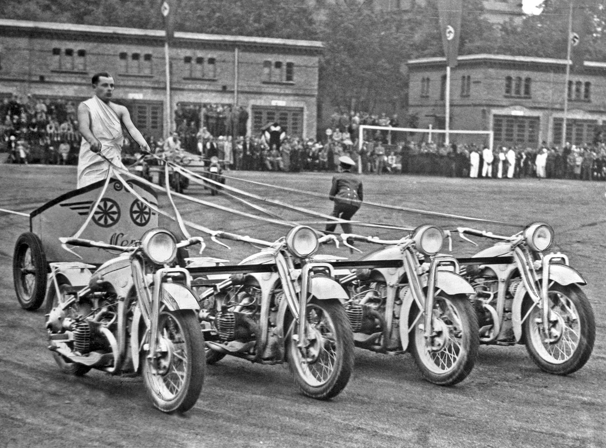 A German Army soldier drives a 'team of motorcycles from a chariot in a competition race at the Potsdam Army Show Germany September 5 1938 1